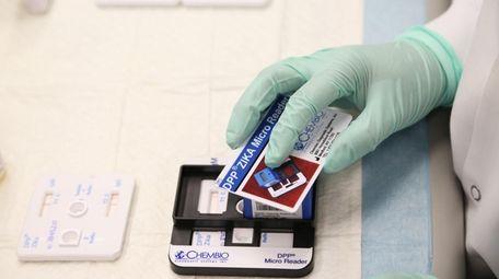 Junior Scientist Melissa Ahrens performs a laboratory test