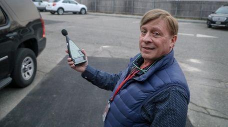 Lindenhurst mayor Mike Lavorata demonstrates how a noise