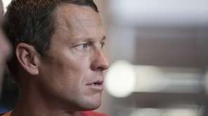 U.S. cyclist Lance Armstrong looks on during an