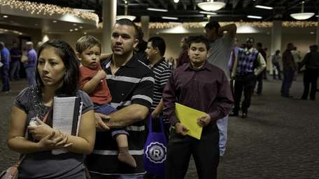 Job seekers in San Antonio, Texas, wait in