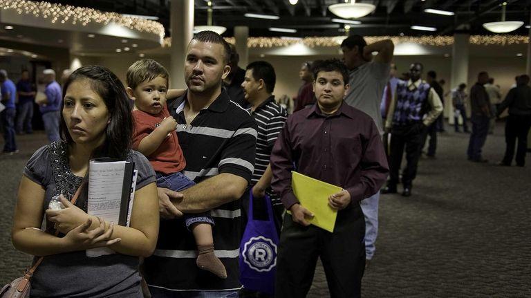 Job seekers in San Antonio, Texas, wait in
