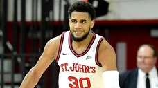 LJ Figueroa of St. John's celebrates a three