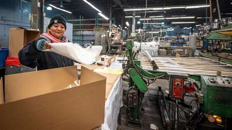 Machine operator Amalia Cruz, 54, of Huntington, packaging