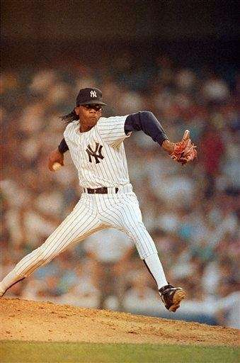 Yankees pitcher Pascual Perez throws to the plate
