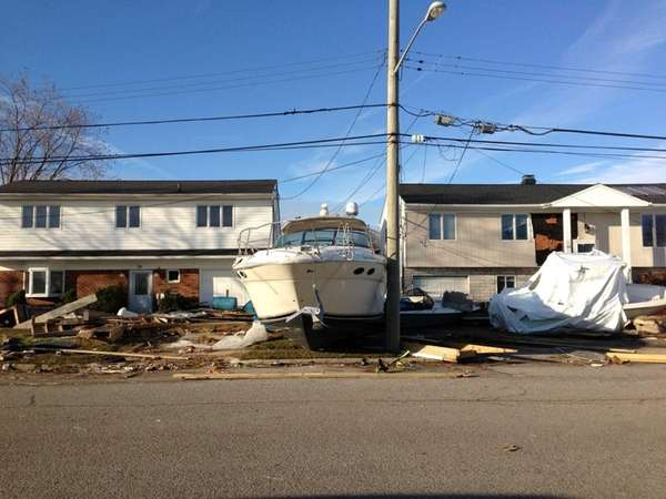 Superstorm Sandy caused scattered boats to damage homes