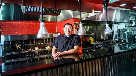 Co-owner and chef Israel Zavala at Holy Smoke