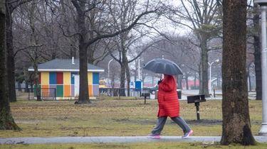 Despite wet conditions, a walker still gets in