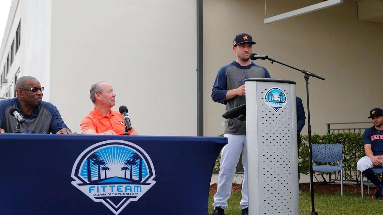 Astros owner Jim Crane and players Jose Altuve
