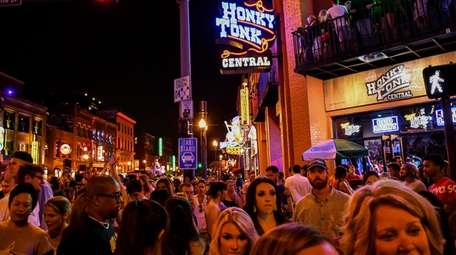 Weekend crowds fill the streets of Nashville's raucous