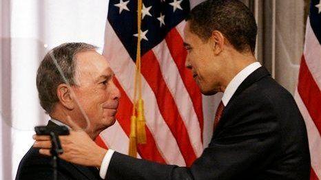 New York Mayor Michael Bloomberg, left, shakes hands