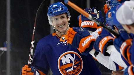 Cole Bardreau of the Islanders celebrates his second-period