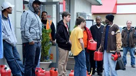 People line up with their gas cans hoping