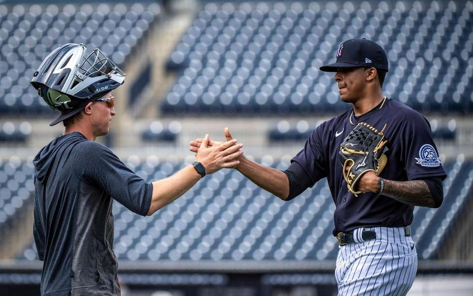 Yankees' catcher Winston Sawyer, left shakes hands with