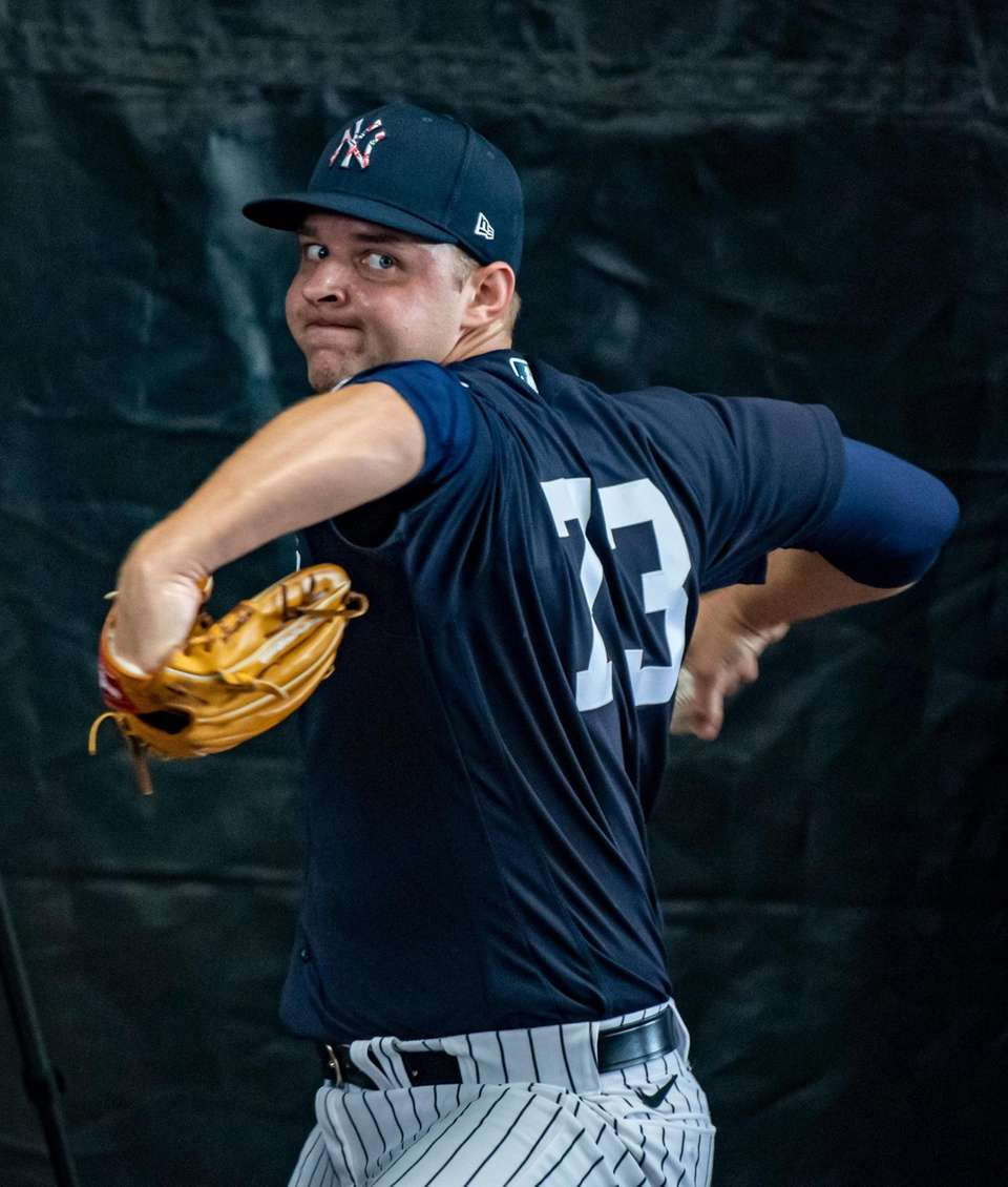 New York Yankees' pitcher Michael King throwing in