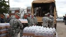 The National Guard brings bottled water to residents