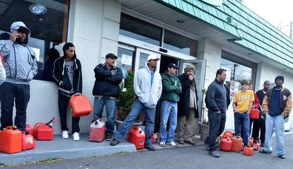 People line up with their gasoline cans hoping