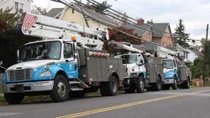 Con Ed trucks line the road in New
