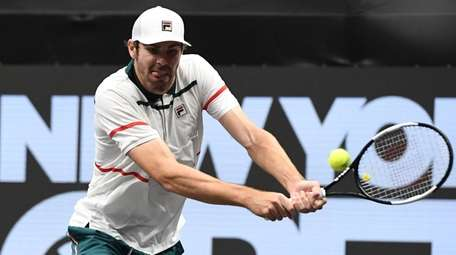 Reilly Opelka returns to Yoshihito Nishioka during the