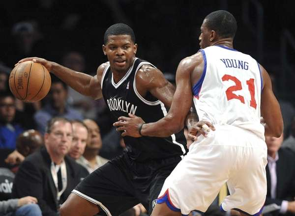 Joe Johnson tries to dribble past Philadelphia 76ers