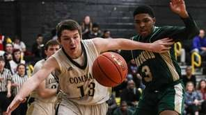Commack's Thomas Abbott tries to keep the ball