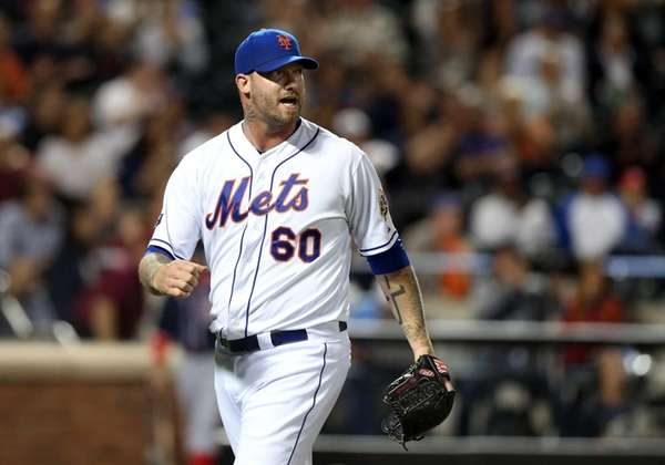 Jon Rauch celebrates the final out of the