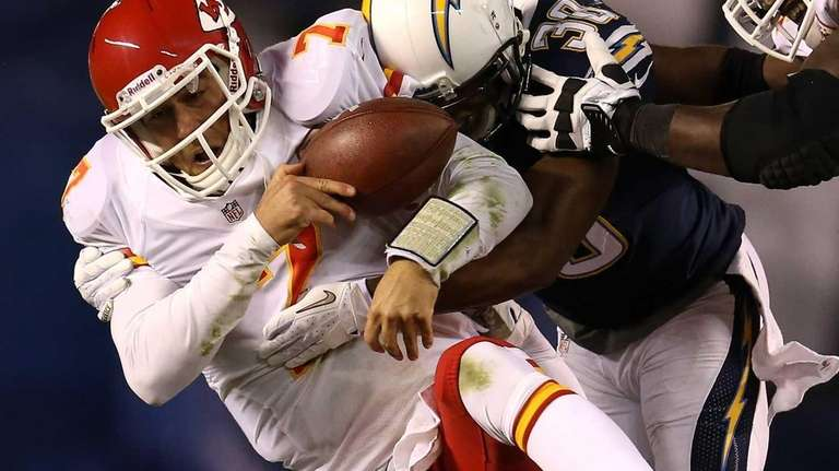 Chiefs quarterback Matt Cassel is tackled by Chargers
