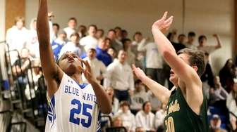 Riverhead guard Adrian Johnson goes in for the