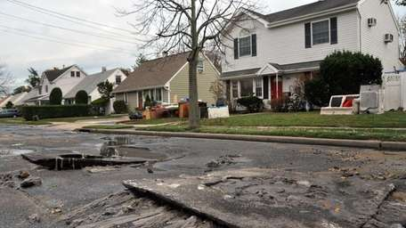 Raw sewage spilled out of manholes and onto