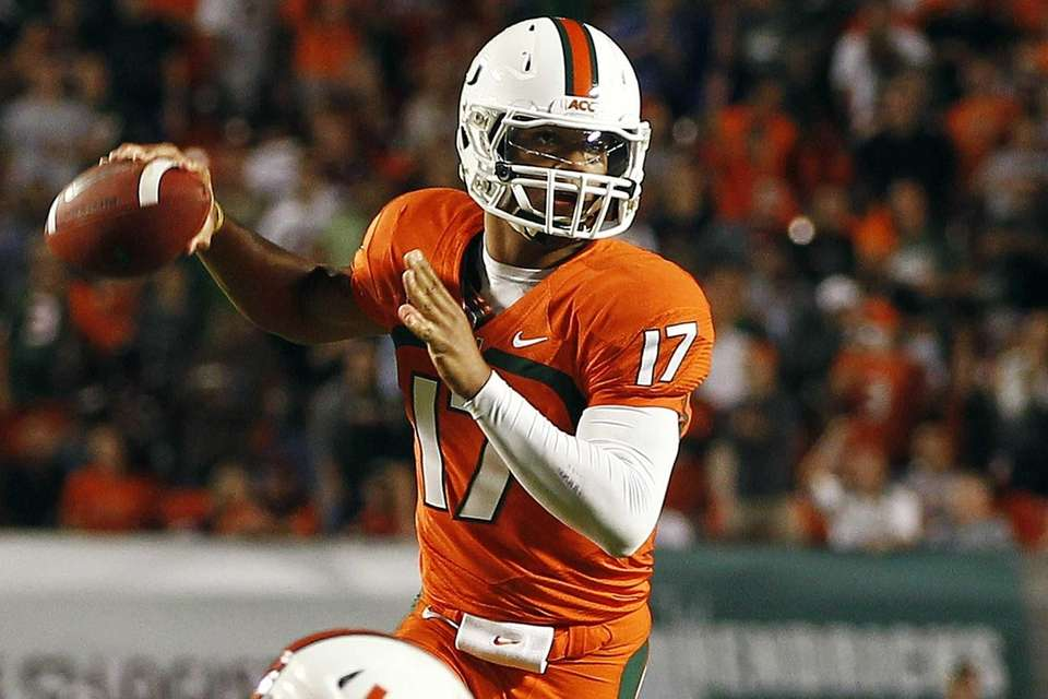Miami quarterback Stephen Morris throws a pass during
