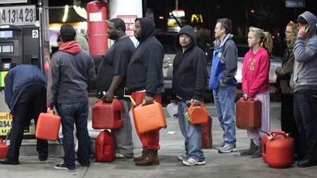 People wait on line with their gas cans