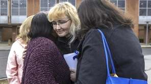 On Thursday, Justyna Zubko-Valva spoke outside the Suffolk Country