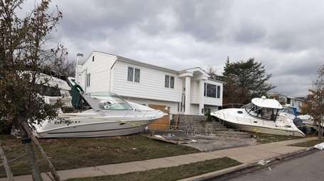 Boats sit on a property on Bayberry Avenue