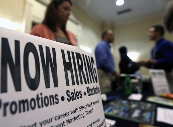 A sign attracts job-seekers during a job fair
