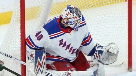 Rangers goalie Alexandar Georgiev stops a shot during