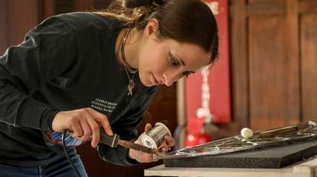 Alyssa Feihel uses soldering gun to add extra