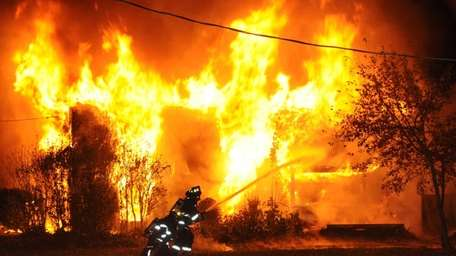 Firefighters battled a blaze at a large two-story