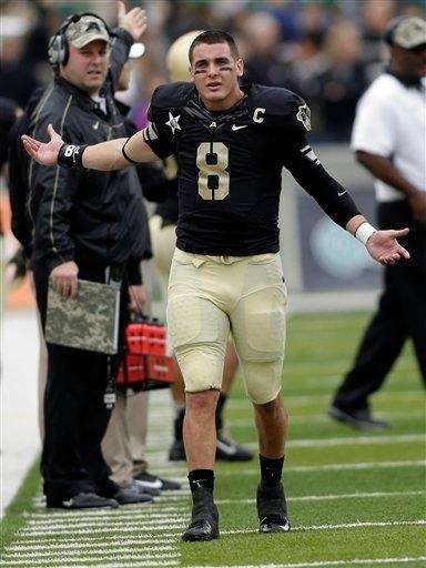 Army quarterback Trent Steelman reacts on the sidelines
