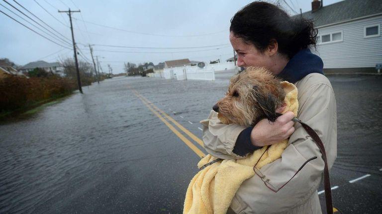 Heather Moline, of Oakdale, wraps her dog Tokio