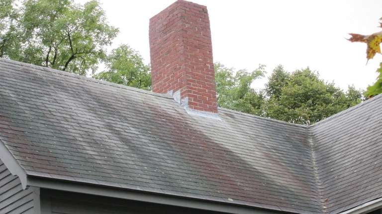When cleaning a roof stained by algae, avoid