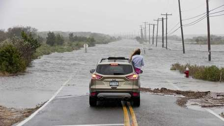 Napeague Meadow Road is covered by flood waters