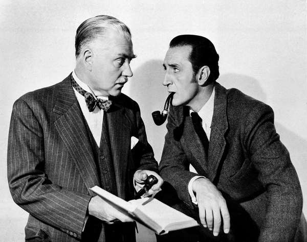 Basil Rathbone, right, as Sherlock Holmes, and Nigel