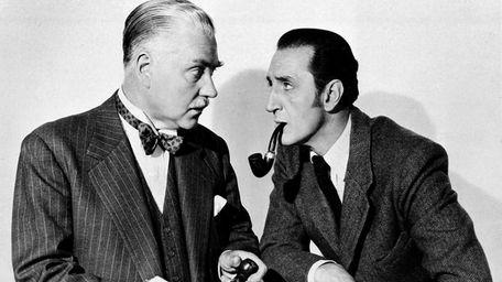 Basil Rathbone, right, as Sherlock Holmes, and Nigel