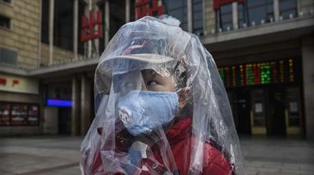 A Chinese boy is covered in a plastic