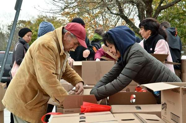 Gus Friedl, left, 87, of Brentwood, is assisted