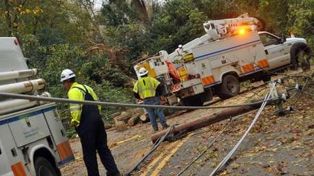 National Grid workers assess roads that remain completely