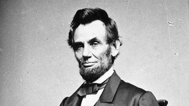 A photographic portrait is displayed showing Abraham Lincoln,