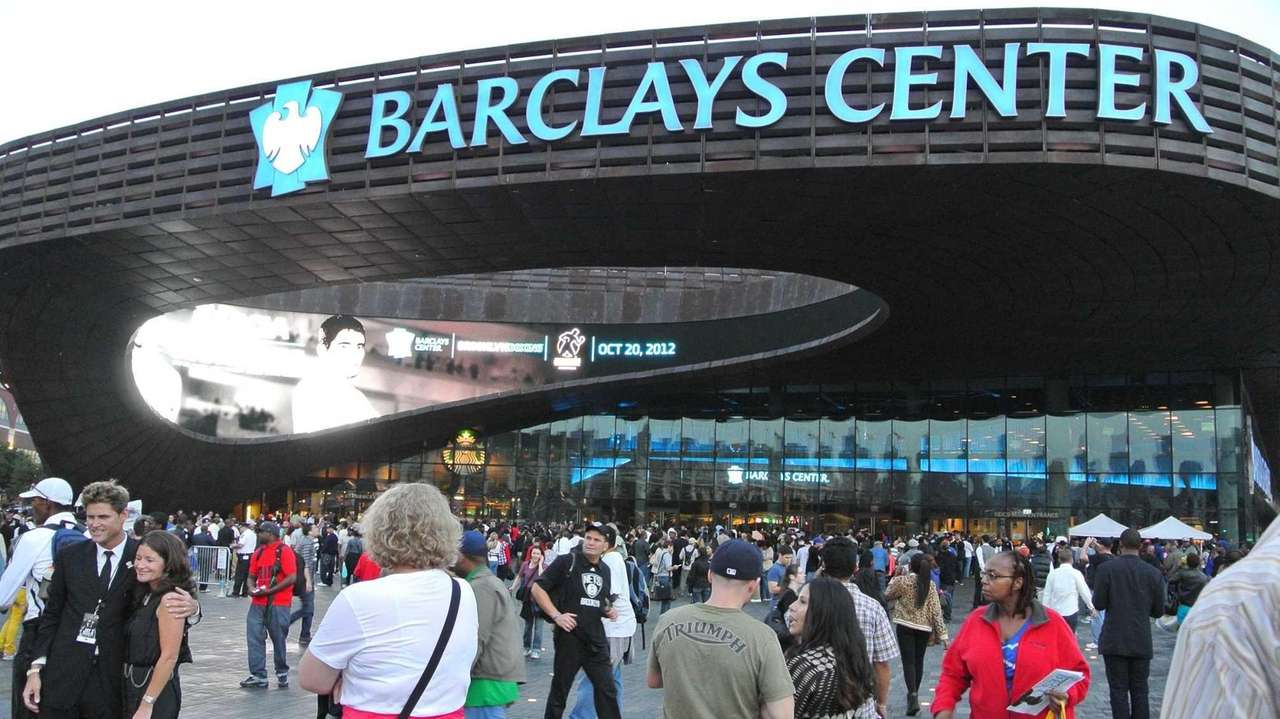 A large crowd gathers outside Barclays Center in