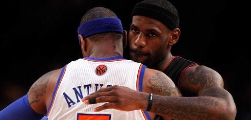 LeBron James of the Miami Heat greets Carmelo