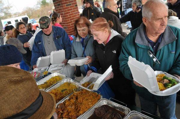 Red Cross Disaster Relief volunteers distribute hot food
