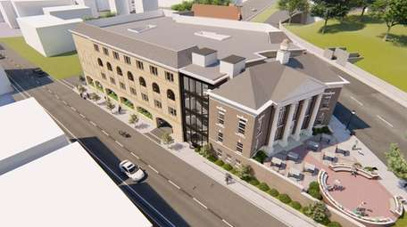 An architect's rendering shows the proposed Hampton Inn,